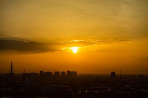 Sunset with yellow sky in urban
