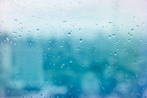 Rain drop on window blue tone