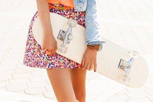Beautiful girl with skateboard.