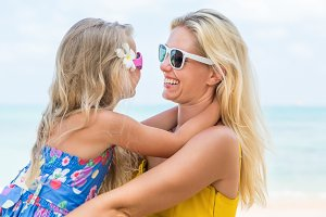Happy Mothers day. Girl, mom, beach.