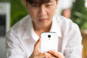 Asian man hold smartphone