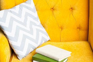 Books on Luxury yellow sofa