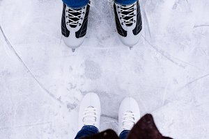Woman and man ice skating