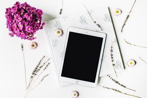 Tablet, wedding album and flowers