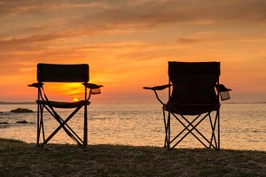 Chairs at the beach on sunset