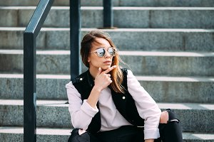 Fashion hipster cool girl in sunglasses. .urban background,fashion look.