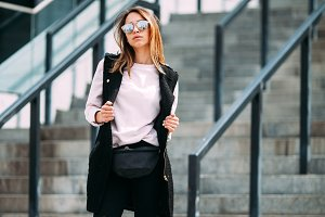 Fashion hipster cool girl in sunglasses. .urban background,fashion look