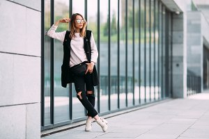 Outdoor fashion portrait of stylish hipster cool girl wearing sunglasses
