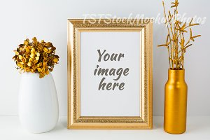 Frame mockup with golden vase