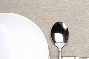empty plate with spoon