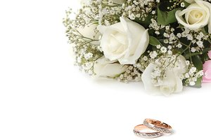 Wedding bouquet and gold rings