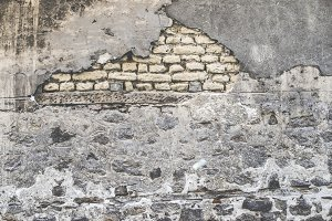 Old brick wall and plaster wall