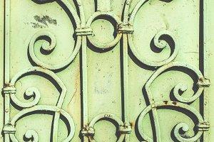 Green metal ornamental fence