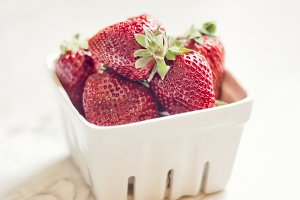 Strawberries on a white basket