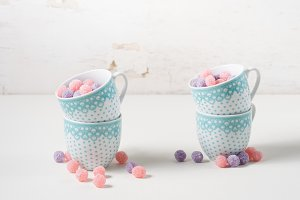Bonbons in coffee cups