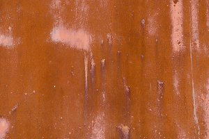 rusty iron fence board stained background