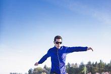 Man running in a promenade outdoors. Man is training