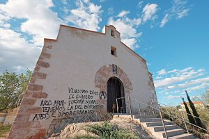 Little chapel with loutish graffiti