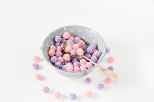 Pastel colored bonbons in a bowl