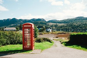 Red Telephone Booth on the Road