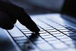 Finger pressing computer keyboard