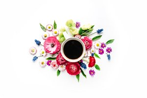 Cup of coffee and floral composition