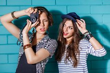 Young girls with photo camera.