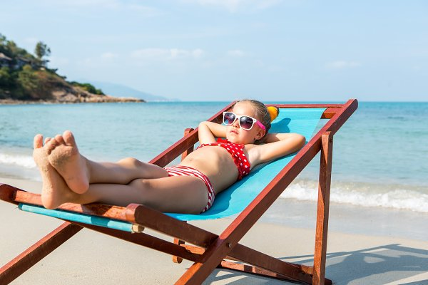 Cute lady in beach chair.