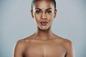 Single beautiful woman over gray background