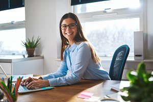 Enthusiastic woman working at desk