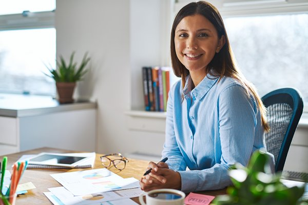 Smiling professional woman working…