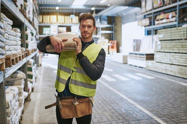 Young handyman selecting supplies i…