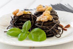 Black spaghetti on white table
