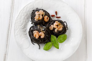 Plate of black spaghetti with prawn