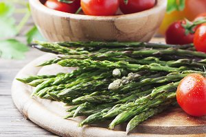 Asparagus with tomato, square image