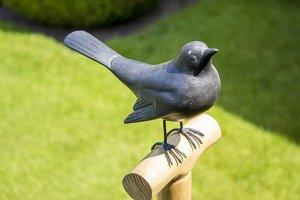 Bird sculpture on a spade handle