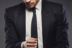 Businessman adjusting his cuff or cufflink