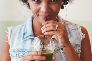 Attractive african woman drinking