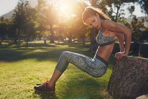 Young woman practicing push ups