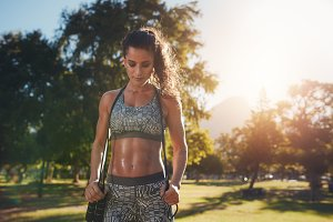 Fit and athletic woman in park