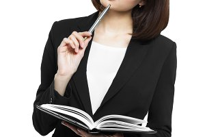 business woman holding a diary and pen isolated on white