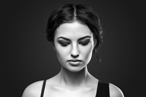 Portrait of beautiful female model on gray background