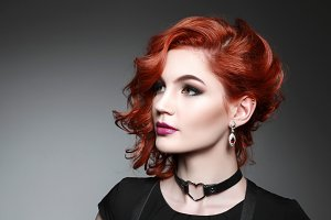 beautiful woman with red hair in a black dress