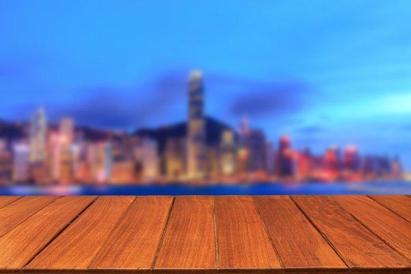 Wood table top on blur capital city