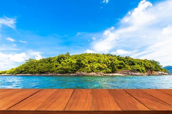 Wood table top on tropical sea