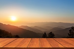 Wood table top on sunrise