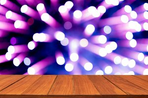 Wood table top on blur firework