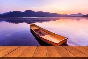 Wood table on serene lake