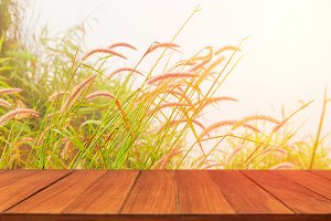Wood table top on vintage grass