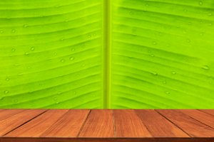 Wood table top on banana leaf